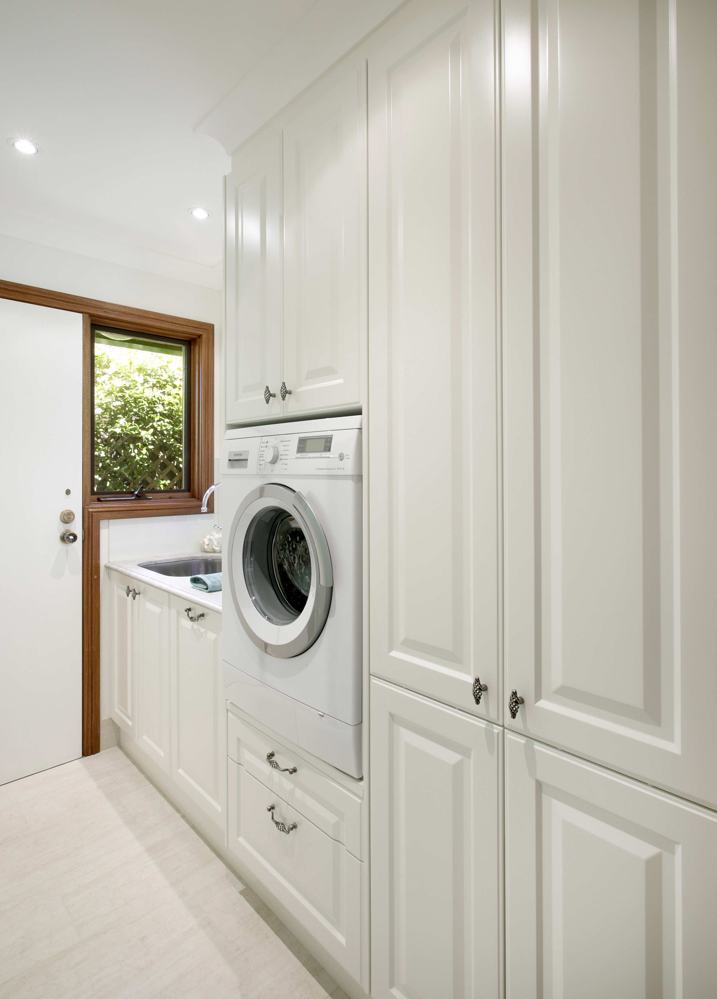 Laundry cupboards sydney for Designer kitchens and bathrooms